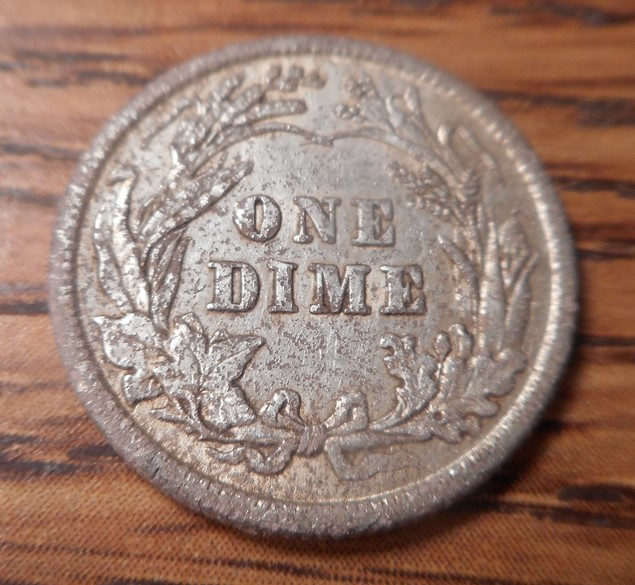 Reverse of 1912 Barber dime, found in hole with nail- great shape- regardless of pitting.