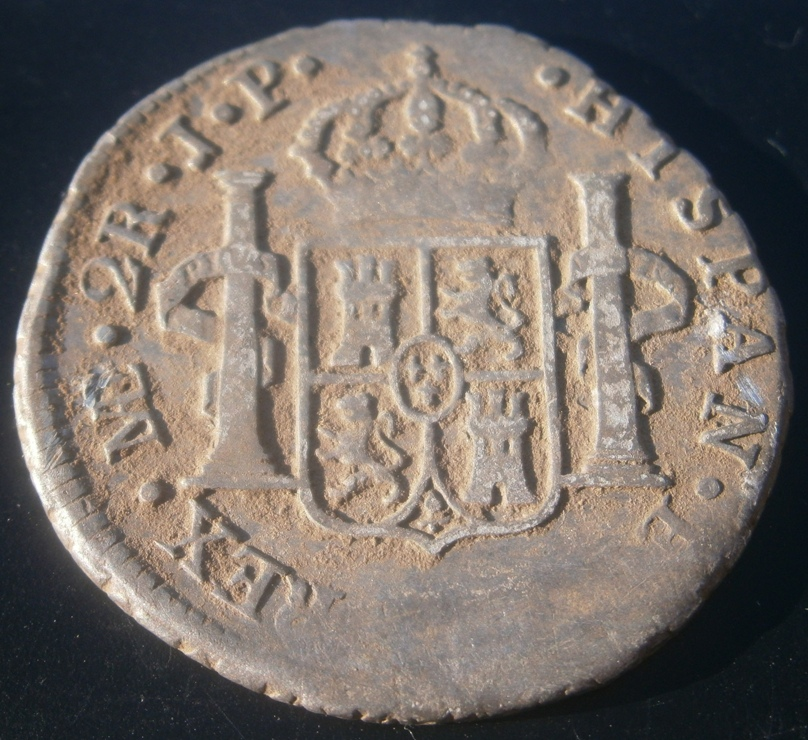 Reverse of 2 Reales, found by Mike Silvia in RI park- great shape except for date area.