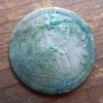 1850-O Seated Liberty Half dime, stained from being stuck to a Nova Scotia penny