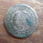 1850-O Seated Liberty Half dime, rev, stained from being stuck to a Nova Scotia penny
