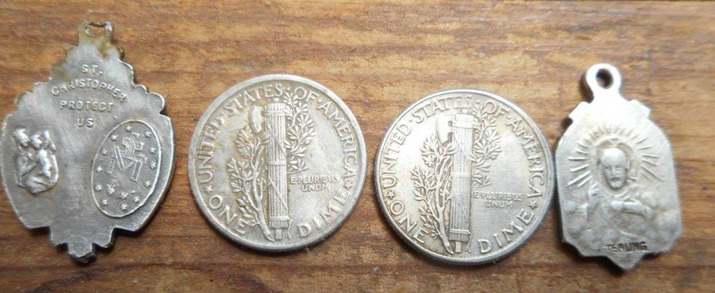 Reverse of silver dimes and religious medallions- FR Park